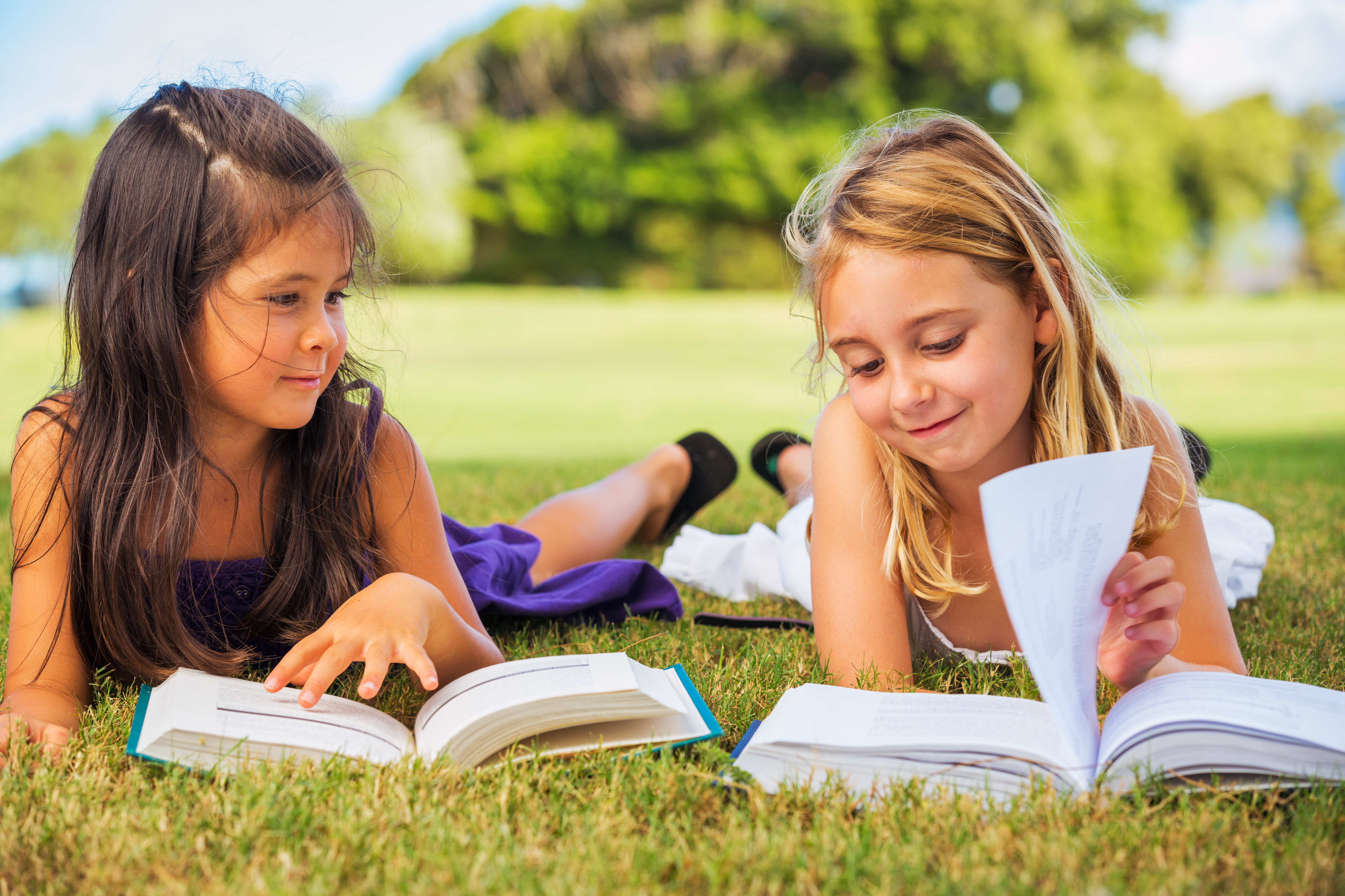 Cute Little Girls Reading Books Outside, Friendship and Learning Concept